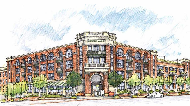 A rendering of Crescent Main Street, a $41 million apartment community under construction in Durham, that could be sold to a new investor as part of a portfolio sale by developer Crescent Communities.