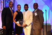 Shawn Wilson president of Usher's New Look Foundation, left; Lisa Borders, chair of The Coca-Cola Foundation, which won the Service Legacy Award; Usher Raymond IV, founder; and Virgil Roberts, chairman of the board.