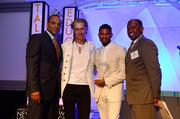 Shawn Wilson president of Usher's New Look Foundation, left; Ed Roland, Youth Catalyst Award winner; Usher Raymond IV, founder; and Virgil Roberts, chairman of the board.
