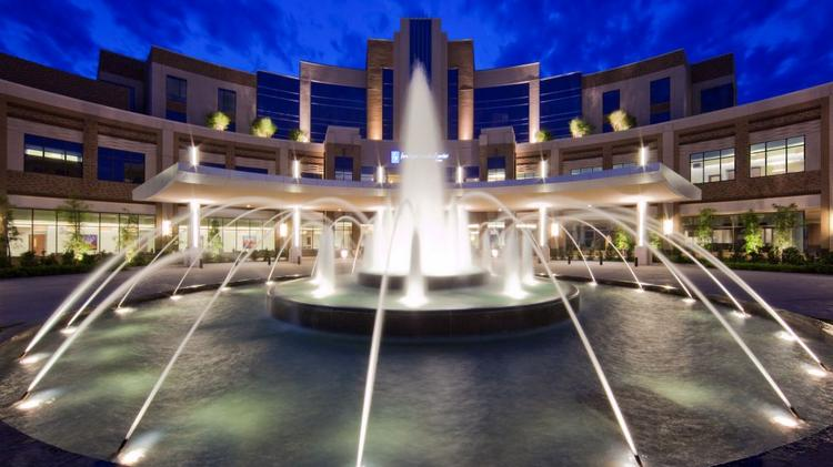 Forest Park Medical Center at Frisco, shown here at night, is operating in Chapter 11 bankruptcy protection.
