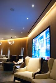 Mason Bar seats 100 with a 9-screen media wall.