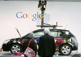 The Google Street View project isn't just happening in the United States. Visitors look at a Google street view car on display at the CeBIT technology fair in Hanover, Germany.
