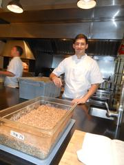 Chef and co-owner Blaine Wetzel with a tub of ingredients to make rye bread, in his kitchen at Willows Inn on Lummi Island. His cuisine has received high marks from national food magazines and reviewers, and the restaurant is extremely popular.