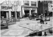 Newly laid stones are cleaned on the 16th Street Mall during construction of the mall in October 1981.