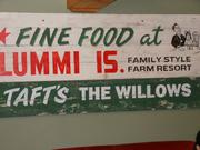 A piece of history, this old sign was found decades ago in the attic of the Willows Inn on Lummi Island. The sign now hangs in the Taproot Café below the inn, where espresso and more casual foods are served.