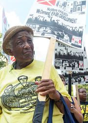 "Dorothy Neal with United Workers participates Wednesday in a Unite Here Local 7 rally in front of City Hall against a $107 million Harbor Point tax incentive. The rally was organized as part of United Workers' ""Campaign for Fair Development."""