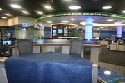 Golf Channel's news desk allows viewers to see the new newsroom expansion in the background.