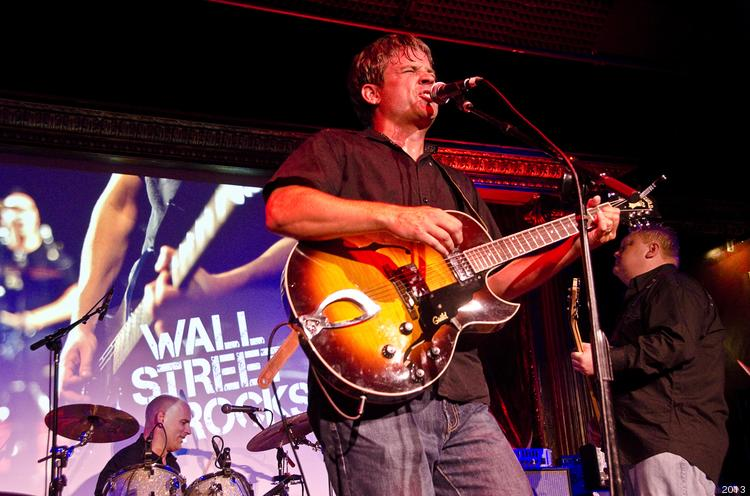 """The lead singer of Mneumonics opened Wednesday night's Wall Street Rocks show with covers of """"Summer of '69"""" and """"Sex on Fire."""""""