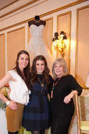 Engaged magazine hosted three bridal showcases March 3 at three of the Washington region's top wedding venues: the Willard Intercontinental Hotel, the St. Regis Hotel and the Decatur House. Employees pose in front of Betsy Robinson's Bridal Collection.