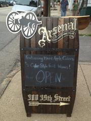 A sandwich board sign, about the only visible evidence from the front of 300 39th St. that reveals the business inside.