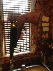 Tap handle made from the replica of a Civil War pistol.