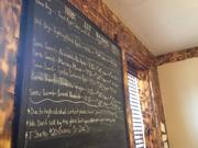 Black board listing the ciders available.