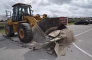 A front end loader performs the groundbreaking for the Rick Case Volkswagen dealership.