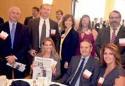 Nicole Wicker and employees with Tearscience at their table.