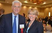 Gary Lynch and Kari Stoltz with Bank of America, an event sponsor, smile for the camera.