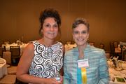 From Aquilent, Debbie Prittchard, left, and honoree Melissa Hook.