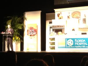Florida Hospital's Des Cummings Jr. welcomes the crowd to the Healthy 100 cooking demonstration at the Bob Carr Performing Arts Center by celebrity Chef Paula Deen.