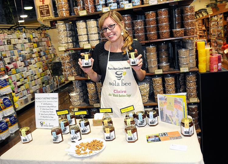 Claire Maygren-Tauzer promotes Sola Bee's honey at a Nugget Market in Davis. Nugget and Whole Foods account for about 70 percent of the company's business.