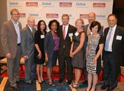 Honoree David White, center, with his team from Choice Hotels International Inc.