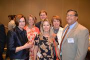 Honoree Cecilia Burtner, left, with her team from HRM Group Inc.