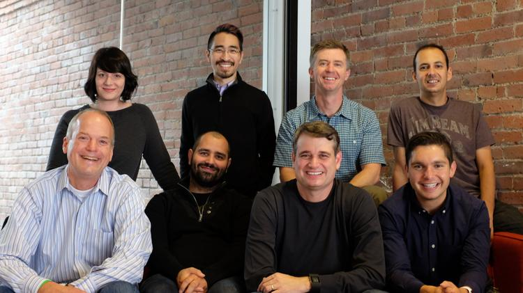 Pioneer Square Labs eight-person team. On the top row, left to right: Leah Severe, Ryan Kosai, Mike Galgon, Marcelo Calbucci. Bottom row, left to right, is: Geoff Entress, Aria Haghighi, Greg Gottesman, Ben Gilbert