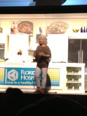Deen talks to the crowd at the Healthy 100 cooking demonstration about her own struggle with diabetes, and cooking and eating healthier.