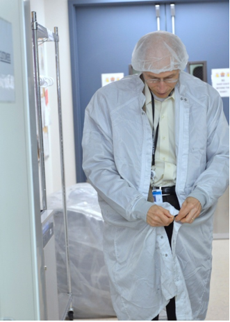 SSL Senior Vice President of Business Development Rich Currier suits up to enter the satellite manufacturing clean room.  Click above to see inside Space Systems/Loral