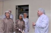David Bernstein, Space Systems/Loral's senior vice president of programs and systems, describes the satellite manufacturing process to Silicon Valley Business Journal reporters Preeti Upadhyaya, center, and Lauren Hepler, left.