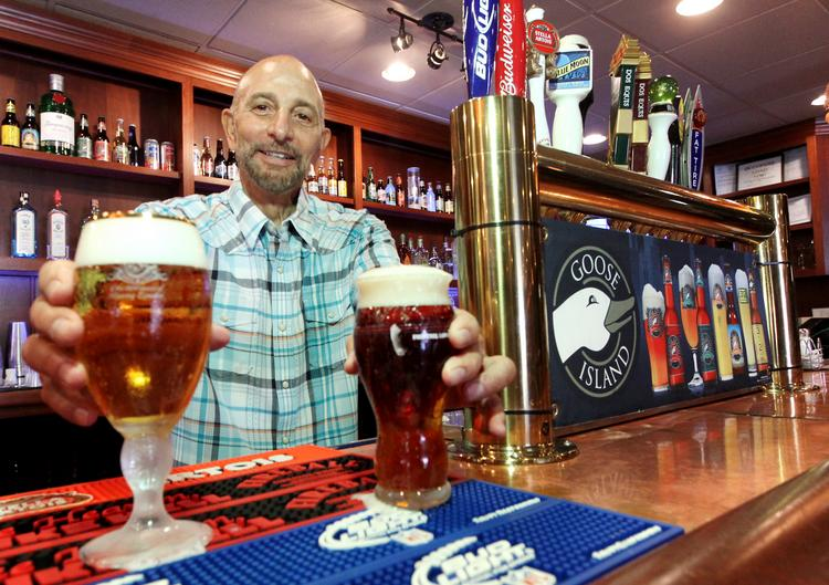 Ken Gattas pours a couple of brews at his relaunched Ned's Bar and Grill.