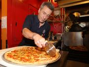 Longtime Albuquerque restaurateur Albert Bilotti works in the kitchen at JC's New York Pizza Department, which he operates.