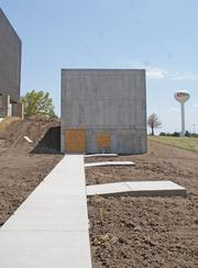 One of the new features at NIAR's facility at the old Kansas Coliseum is a ballistics laboratory.The institute has constructed a large concrete bunker on the west side of the building where it will test how aerospace materials and components stand up against high-energy impacts.A steel pipe will connect to the bunker through which researchers will fire .30-caliber straight shots and .50-caliber tumbling shots at the components.The bunker will also be big enough to do some 30-foot drop testing of some components.NIAR Executive Director John Tomblin says the idea for the new lab came from one aviation supplier — he couldn't say which one — that was having to do the testing out of state.Now, Tomblin says, the lab will add abilities that NIAR can use for other customers as well.