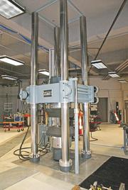NIAR's facility at the Coliseum is now home to a large torsion load frame used to test the stress certain materials and components can withstand. This particular load frame came to NIAR from Tinker Air Force Base in Oklahoma. It had previously been used to test the landing gear on KC-135s and B-1 bombers.