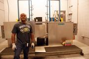 NIAR's Anthony Alford shows off some of the equipment inside NIAR's aging aircraft lab at the Kansas Coliseum.