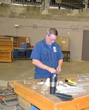NIAR's Brian Jones works on some components on the floor of the Kansas Coliseum.