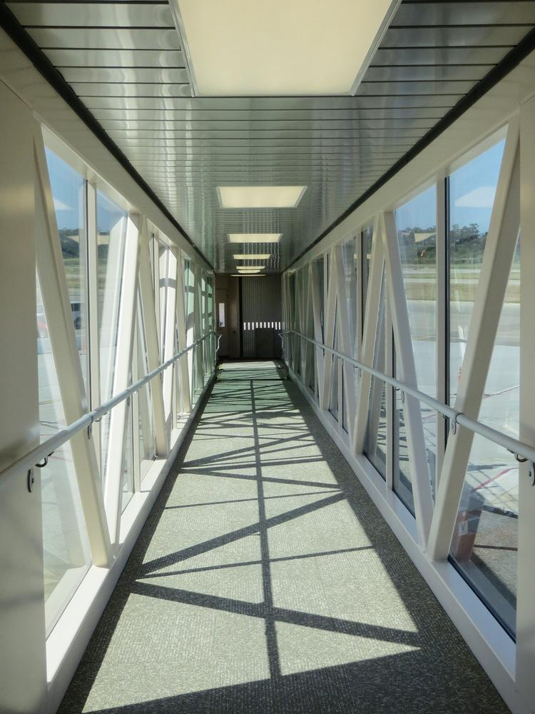 Passengers take glass jetways from the terminal to the planes at Santa Barbara, Calif.'s airport. Wichita's new terminal will include the same feature if the Wichita City Council approves it Tuesday.