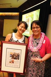 From left, Beth Ito and Priscilla Sullivan of Coffman Engineers receive their award for Healthiest Employer in the small company category.