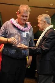 From left, John Buck accepting the finalist award for the County of Maui from John Henry Felix.