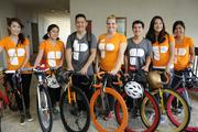 The Empowered Presentations team, from left, Marika McHugh, Britney Aao, Cory Jim, Yancey Unequivocally, Jairus Kiyonaga Sara Tellio and Taylor Oyama rode their bicycles to the PBN Healthiest Employers event.