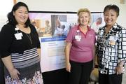 From left, Torri Ishida, Kathy Dittmar and Donna Tsutsumi pose for a photo in front of the Hawaii Pacific Health Booth at PBN's Healthiest Employers event.