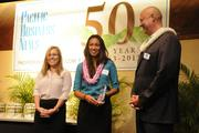 DeAnna Niderost of Hawaii Information Consortium accepts a finalist award as PBN Publisher Bob Charlet looks on.