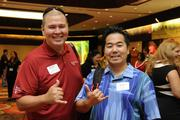 From left, Ken Lincoln of Castle Medical Center and Nobu Shimauchi of Crazy Shirts.