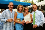 Second from left, Andrea Crisafulli Russo, president of Crisafulli Bros. Plumbing and Heating, and Stephanie and Scott Wylie of Hoosick Valley Contractors