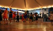 A dance floor was set up under one of the tents