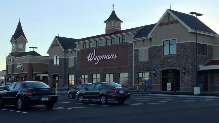 Rochester, New York-based grocery chain Wegmans will open its fourth Massachusetts location at Westwood's University Station mixed-use development this Sunday. Get a sneak peek of the 122,000-square-foot store, which will stock 70,000 products and employ 550 workers.