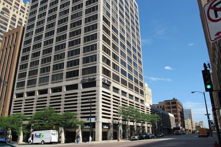 The building has an attached parking structure that stretches along North Broadway between East Wisconsin Avenue and East Mason Street.