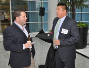 Terry Smith of Atlantic Southern Paving & Sealcoating talks to Brian Flores Lewis of Slaton Insurance.