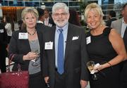 Cindy Tunon of No. 61 Eulen America with Mike Kridel and Susan Kaplan of No. 96 Daszkal Bolton.