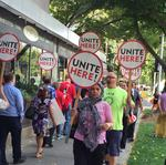 With city minimum-wage proposal in doubt, unions ramp up protests