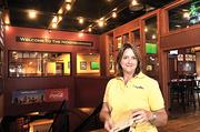 Our Town America franchise owner Jane McElhaney is pictured here at a customer's location, Dilworth Neighborhood Grille. The direct-mail franchise is a national leader in sales -- and is featured this week on the Entrepreneurs section.
