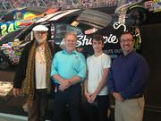 """CBJ Seen: Fleetwood Mack's drummer and co-founder -- and Rock & Roll Hall of Fame member -- Mick Fleetwood stopped into the NASCAR Hall of Fame while here for a concert at Time Warner Cable Arena on June 24. Fleetwood is shown here, from left, with Buz McKim, historian at NASCAR Hall of Fame, his grandson and Kevin Schlesier, exhibits manager at the NASCAR Museum.Want to have your company's events featured in CBJ Seen? Submit them to Alison Angel at aangel@bizjournals.com for consideration. Be sure to include caption information, and put """"CBJ Seen"""" in the subject line."""